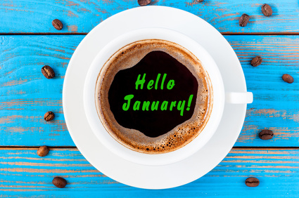 Hello January - text on morning coffee mug. Top view, New year hangover concept. Happy first month of the year