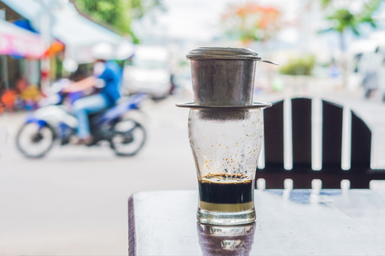 Vietnamese coffee in a street cafe on the background of a road